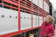 woman looking up at a live animal export truck