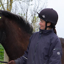 owner looking affectionately at her horse
